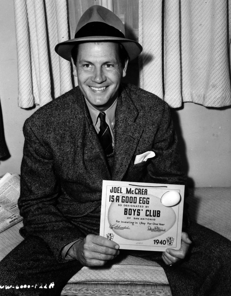 "Joel McCrea with ""Good Egg"" certificate from Boy's Club of San Antonio."