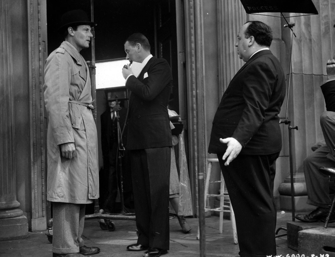 McCrea, Marshall, and Hitchcock discuss a scene.