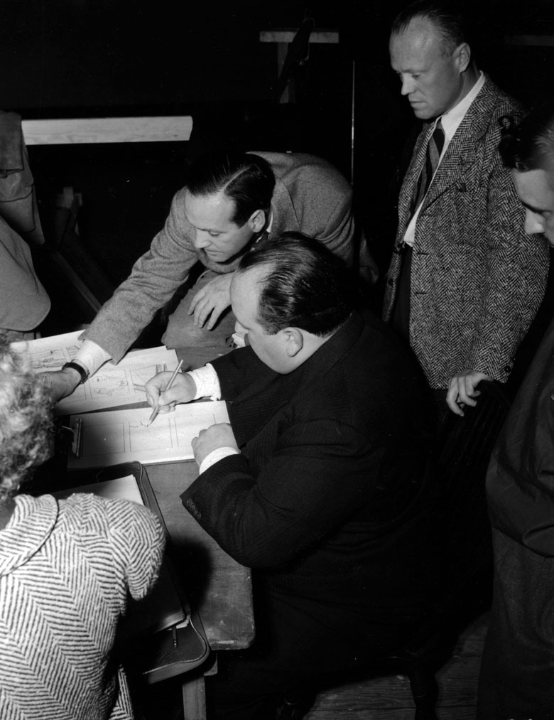 Hitchcock works on a storyboard for Foreign Correspondent.