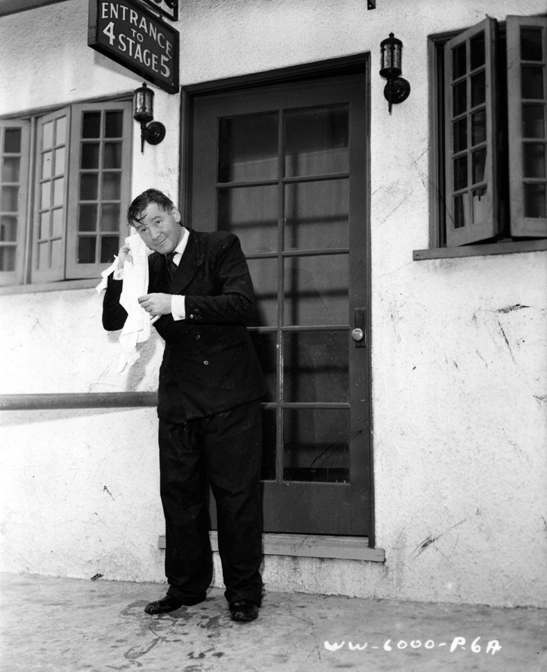 Herbert Marshall dries off after a dip in the water tank