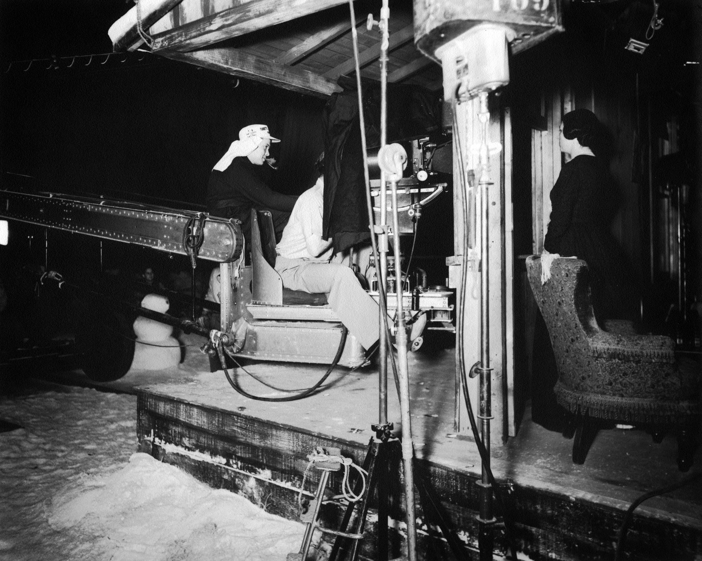 Orson Welles directs Agnes Moorehead on the Kane family homestead set.