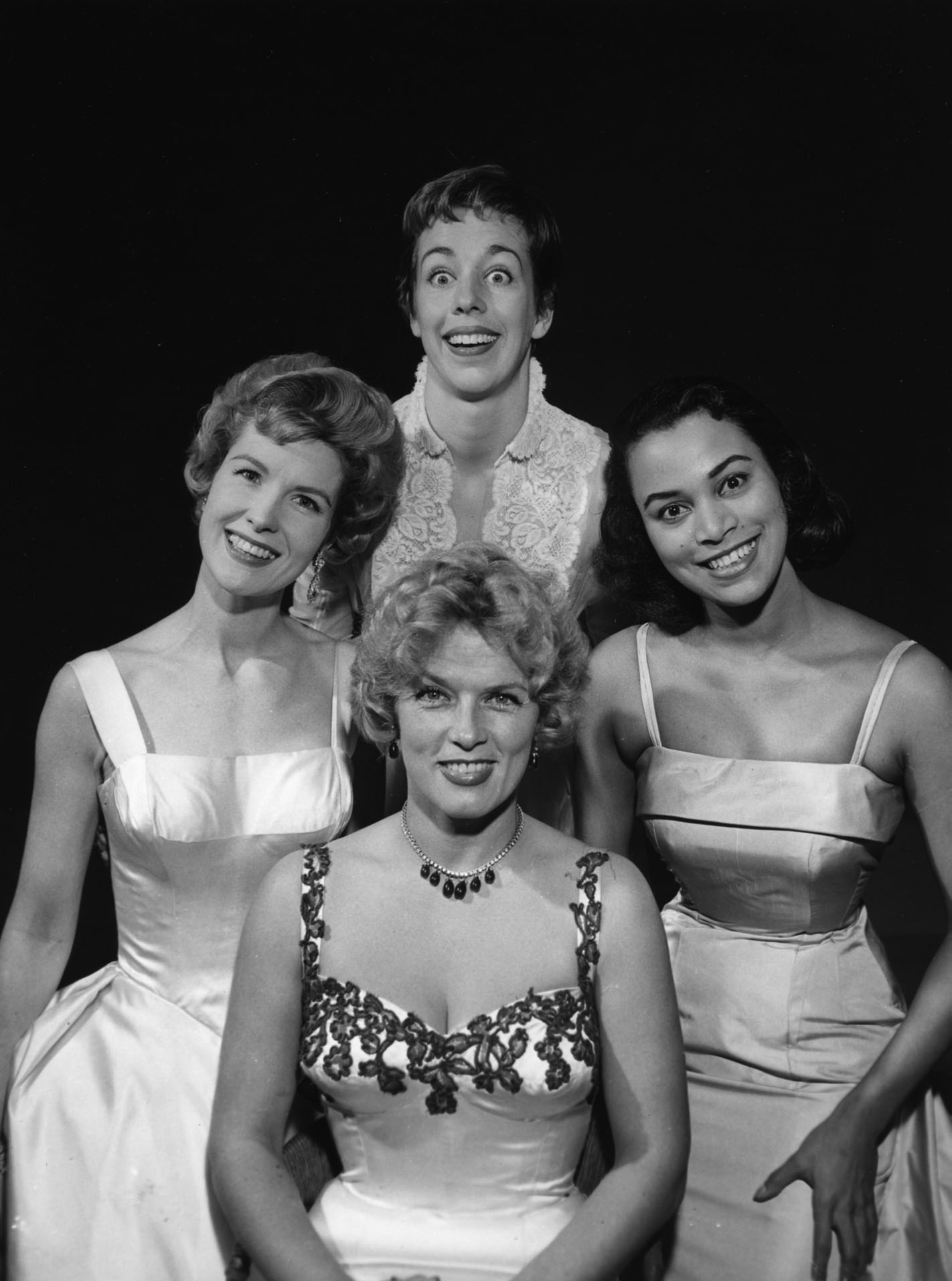 At left: Publicity still of female guests for the broadcast of July 6, 1958. Clockwise from top, comedian Carol Burnett, jazz singer Sallie Blair, French actress Denise Darcel, and GM spokes-model/actress Julia Meade.