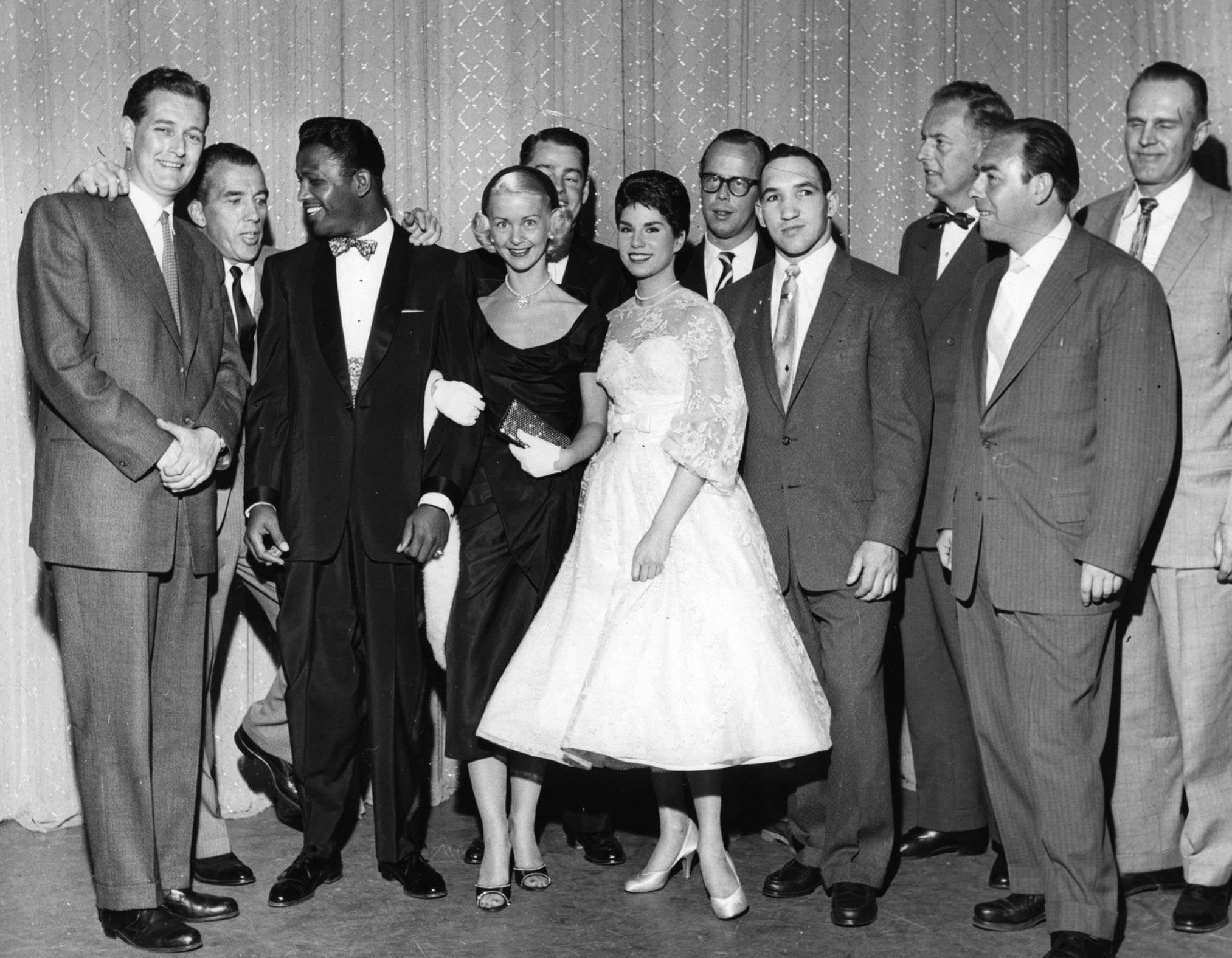 Sullivan (second from left) poses with boxer Sugar Ray Robinson (third from left)