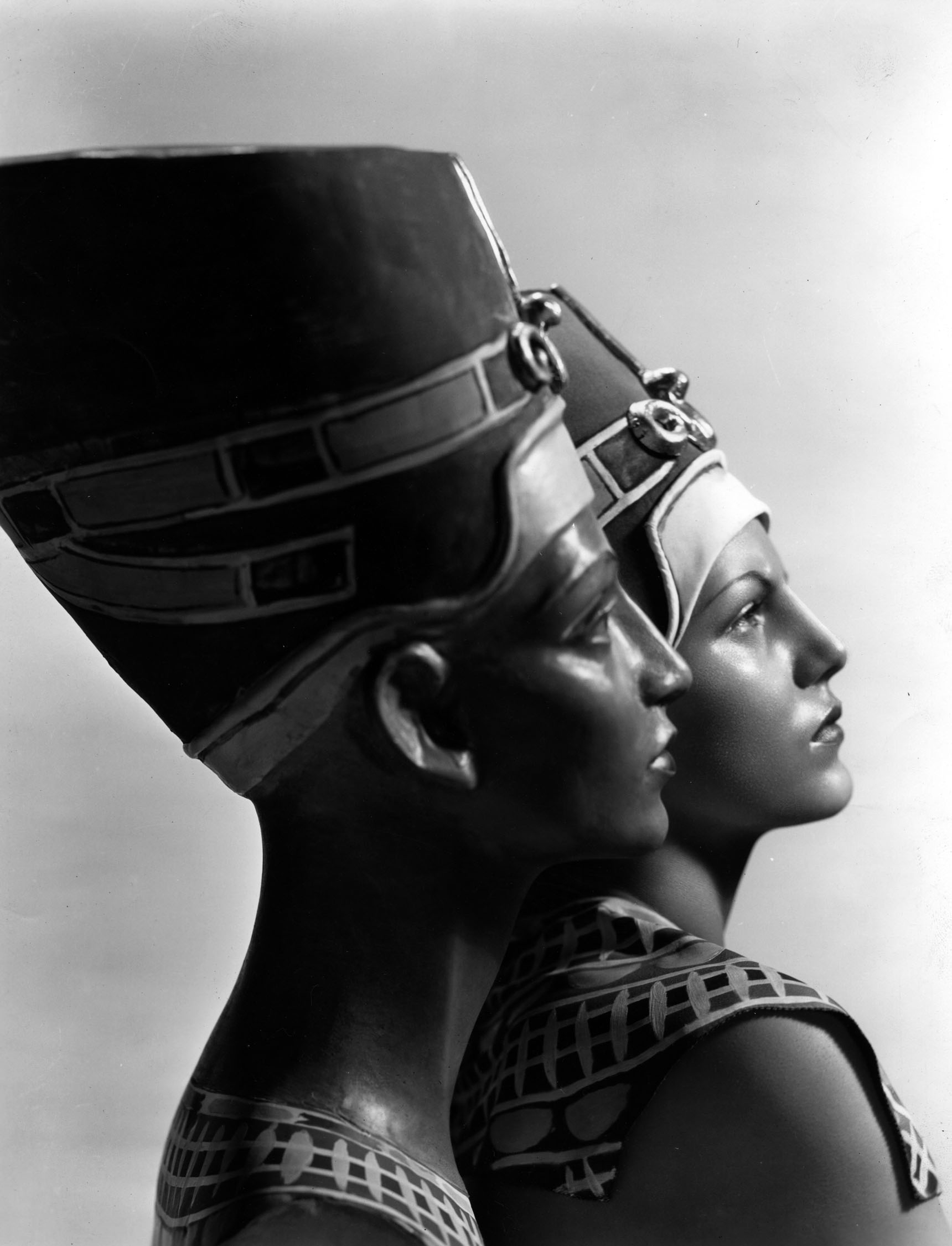 "Fox publicity still featuring Cansino as Nefertiti, circa 1935. Original caption reads:""REINCARNATION?  Nefertiti, Egyptian queen said to be the most beautiful woman of antiquity, seems to have been born again in the person of Rita Cansino, F ox Film debutante star, whose resemblance to the famous statue of the royal beauty is considered remarkable."""