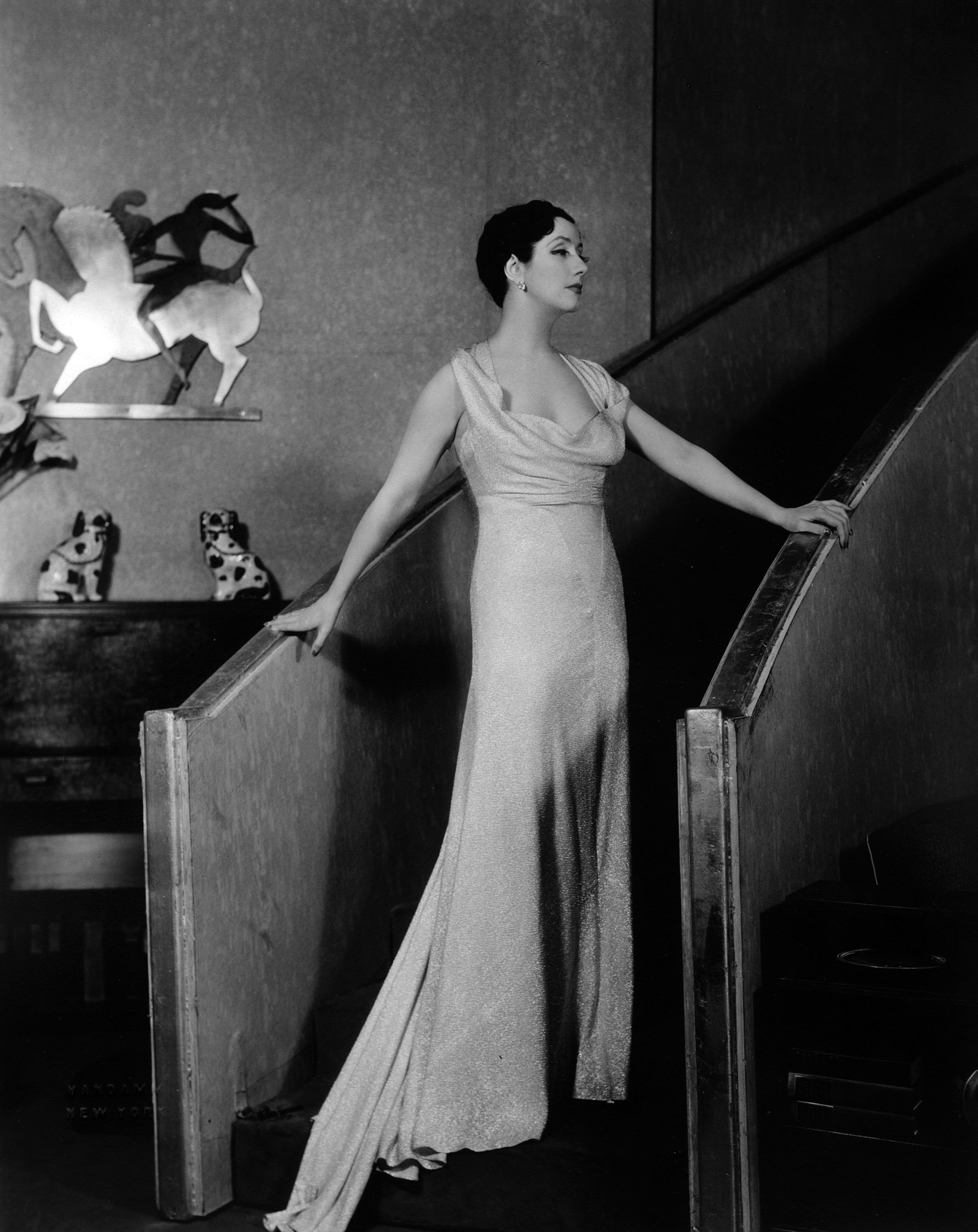 Lynne Fontanne (Gilda) on the elegant stairs of the New York penthouse set.