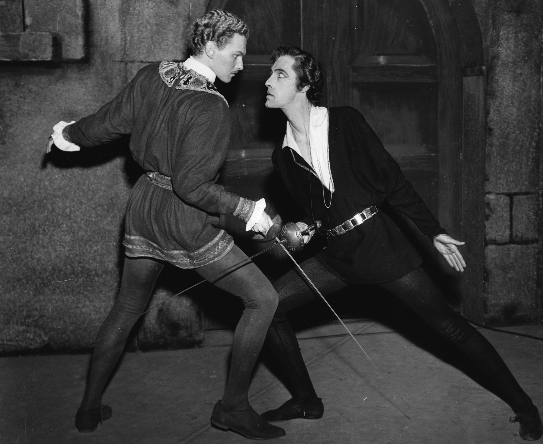 """Original caption reads, """"Robert Duke as Laertes (left) and John Carradine as Hamlet (right) in a production of Shakespeare's play, circa 1943."""""""