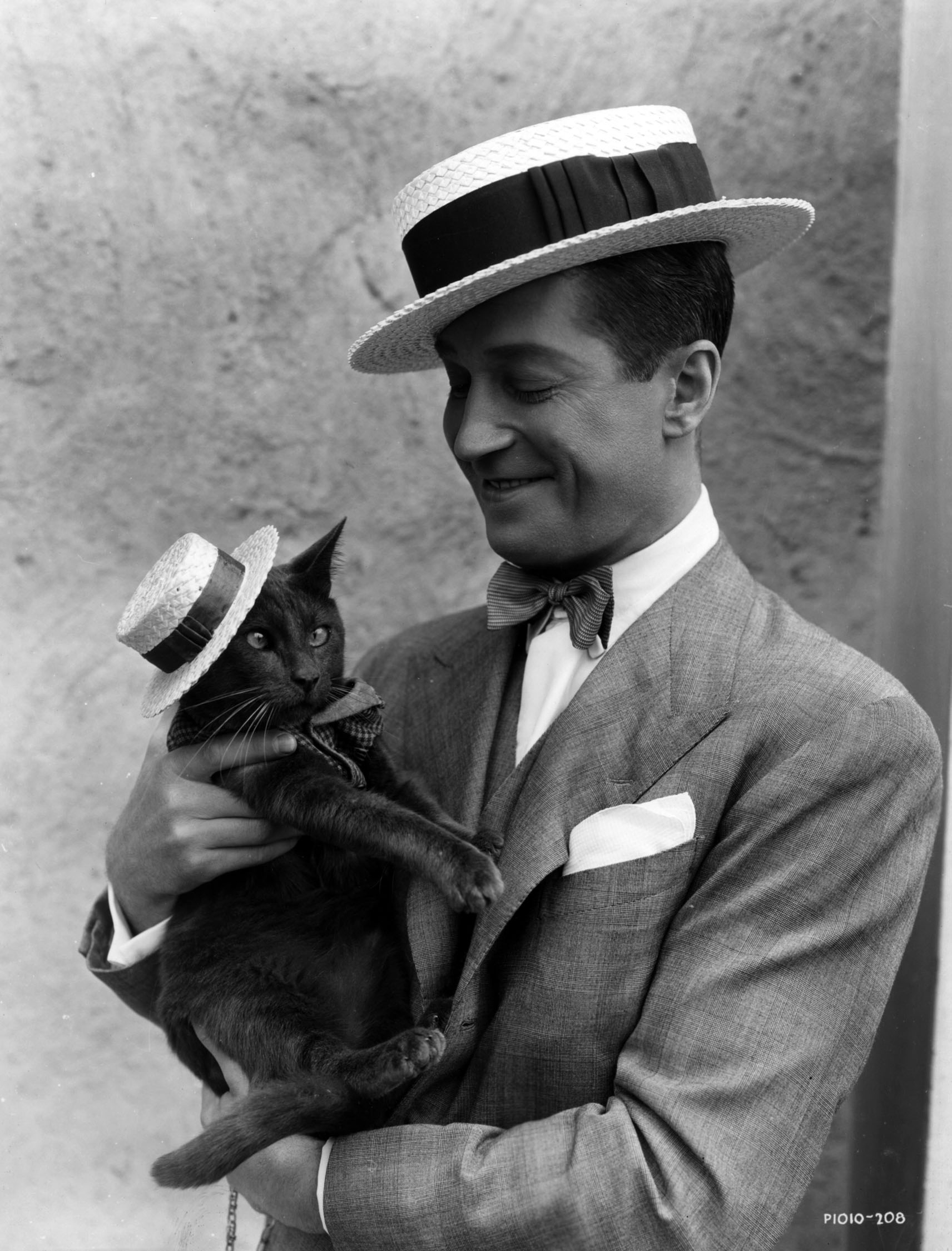 Maurice Chevalier and his (cross-eyed) cat.