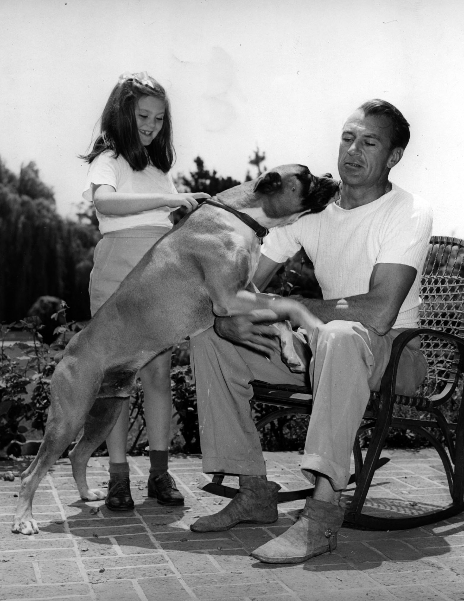 Gary Cooper with his daughter and dog, circa 1945.