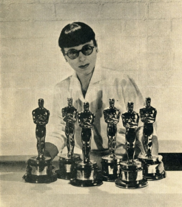 Head poses with 6 of her Academy Awards statues.
