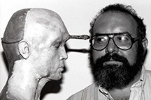 Stuart Gordon right looking at spiked prop head left.
