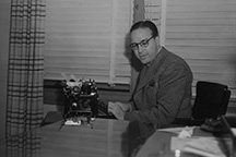 Trumbo at a typewriter.
